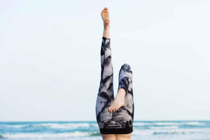 person upside down near seashore
